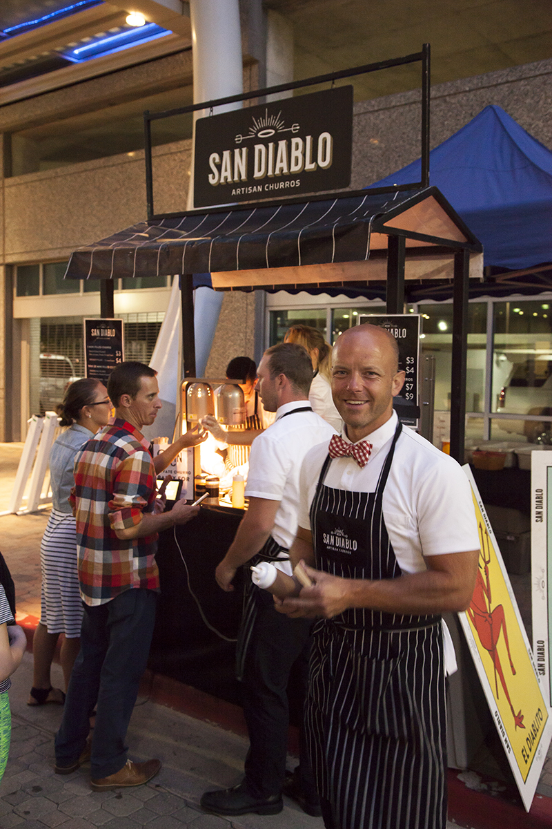 A San Diablo Artisan Churros representative offers samples of their special caramel sauce. Photo: @jbunds