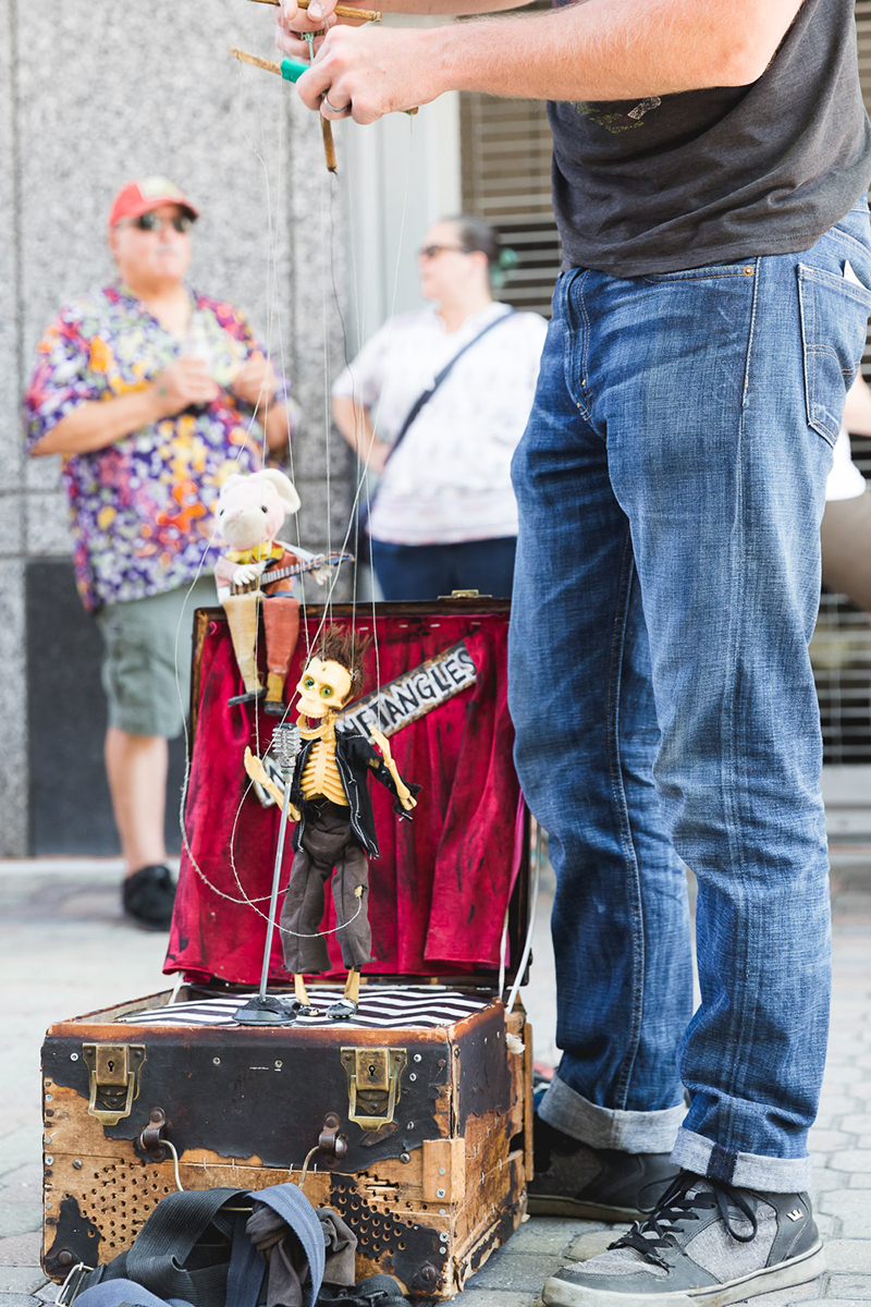 A marionette artist pulls in crowds of people for his show. LmSorenson.net