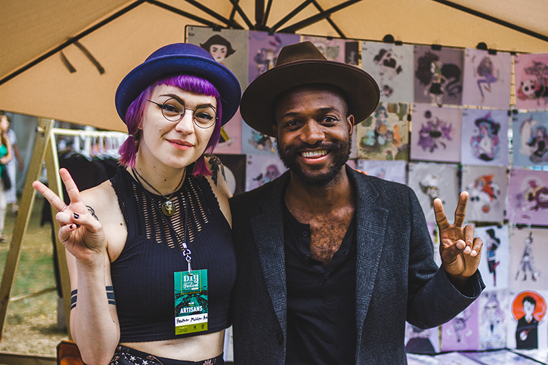 (L–R) Friends Heather Mahler and Joshua Strauther pose for a quick picture in front of Heather's booth. Photo: @taylnshererphoto