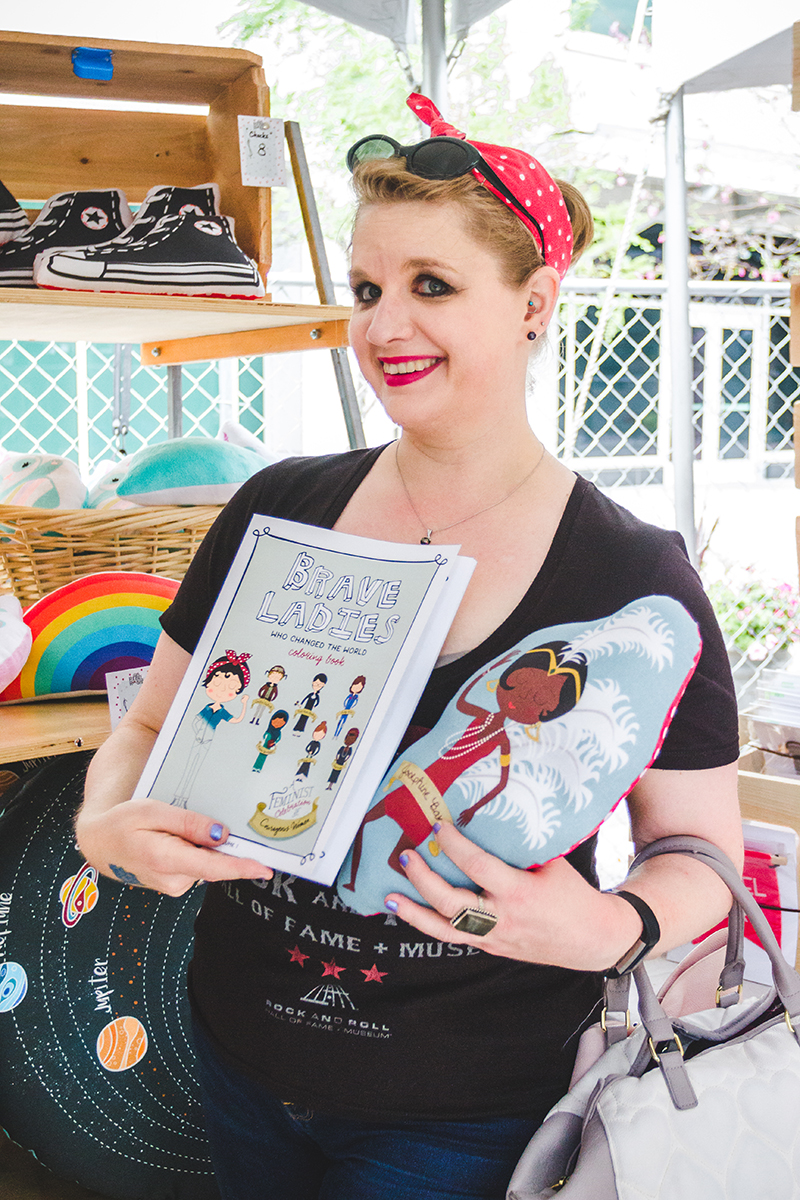 Harnessing her inner Rosie, festival-goer Shannon Charlson shows off her Brave Ladies purchases that feature revolutionary women throughout time. Photo: @taylnshererphoto