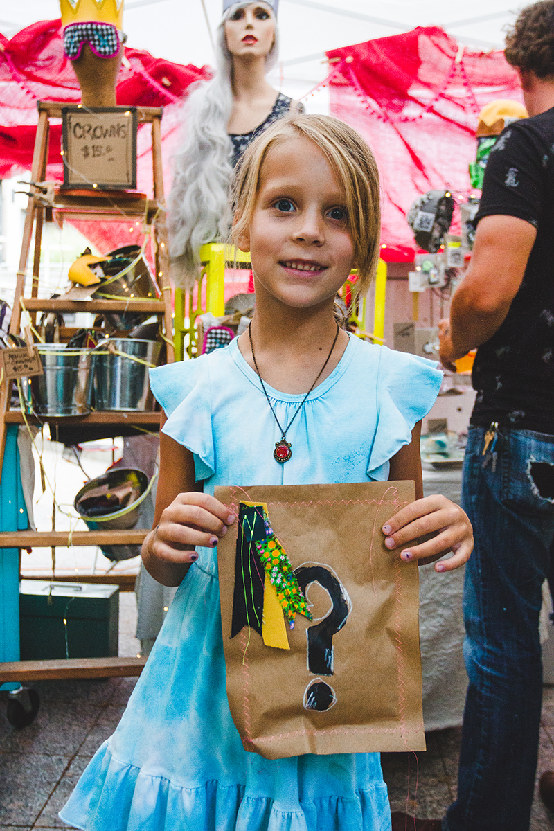 Josie Flickinger is excited to see what her mystery bag from Parker Rose Merc contains. Photo: @taylnshererphoto