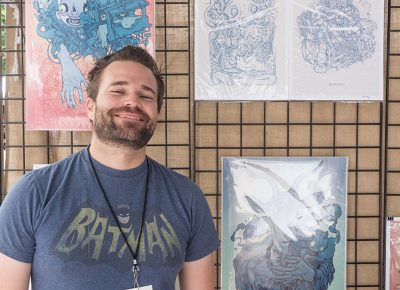 Chris Bodily poses in front of his artwork. Photo: @colton_marsala