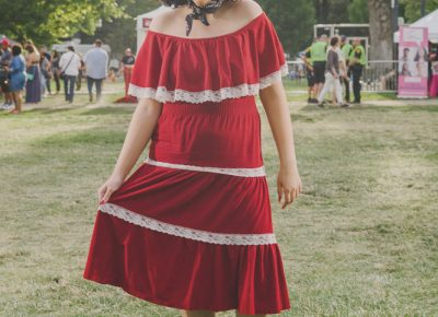 Madi Whitaker in a red dress and bandana. Photo: @clancycoop