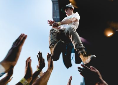 The fan soars over the crowd, jumping from the stage to the sea of hands below. Photo: Lmsorenson.net