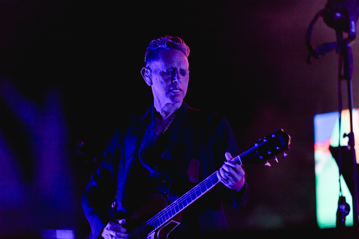 Martin Gore basks in the shadows onstage. Photo: Lmsorenson.net