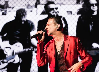Dave Gahan sporting a red sparkling jacket on-stage at USANA. Photo: Lmsorenson.net