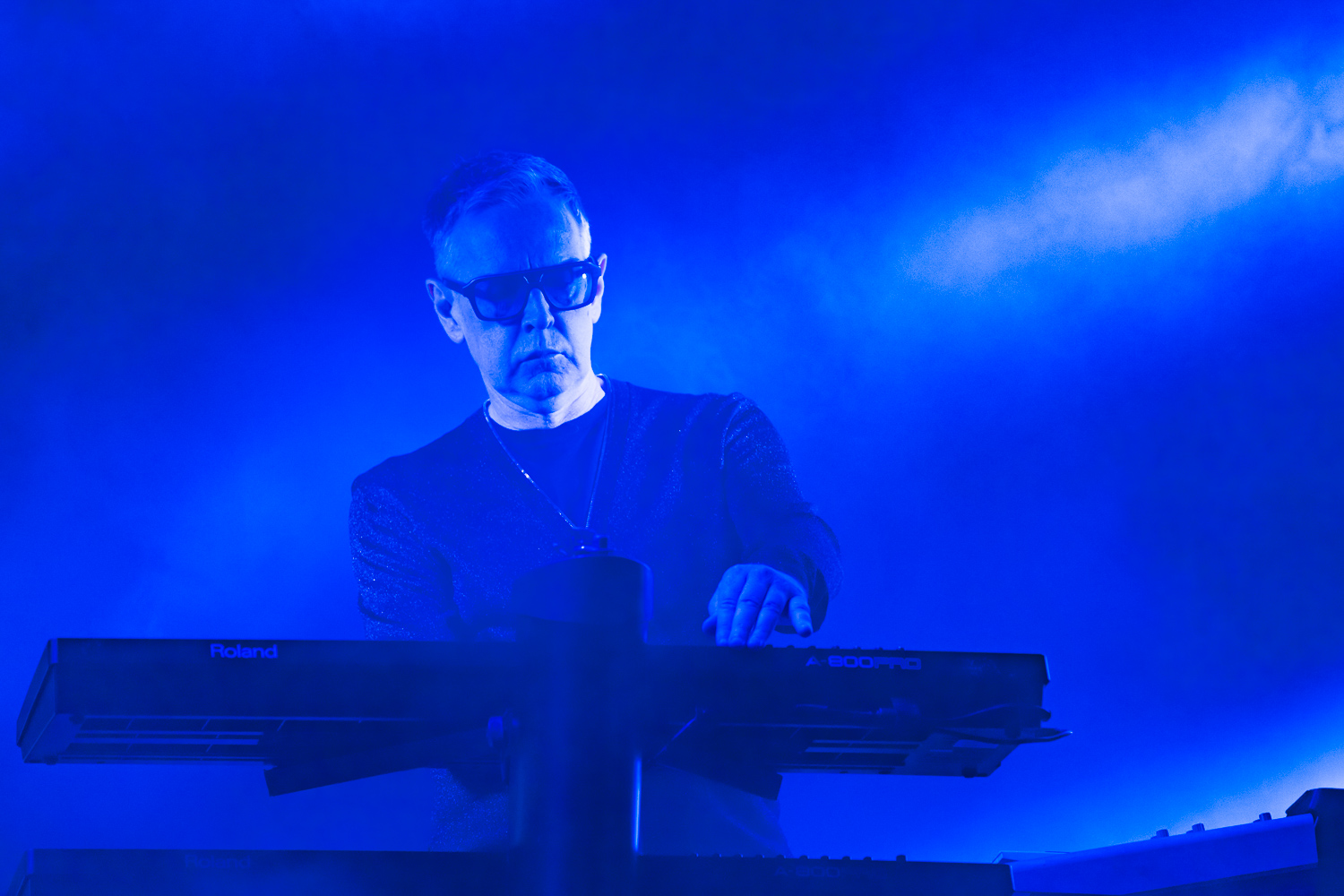 Andy Fletcher playing keys onstage for Depeche Mode. Photo: Lmsorenson.net