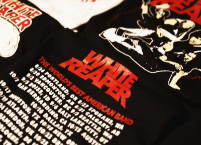 White Reaper merchandise, including T-shirts featuring their newest album. Photo: Lmsorenson.net