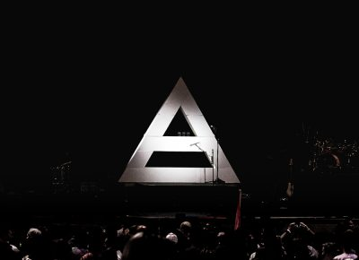 A lit pyramid appears centerstage in the darkness before Thirty Seconds to Mars take the stage. Photo: Lmsorenson.net