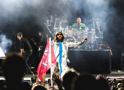 Fans wave flags and chant and sing along as Thirty Seconds to Mars play. Photo: Lmsorenson.net