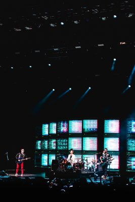Muse put on an almost interactive show with camera feeds from the musicians displayed onto the screens onstage. Photo: Lmsorenson.net