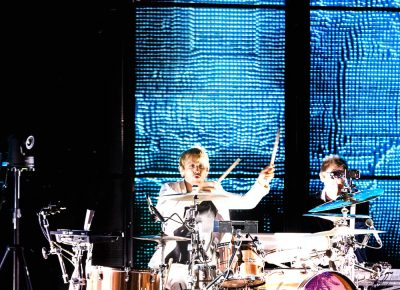 Drummer Dominic Howard playing onstage at USANA. Photo: Lmsorenson.net