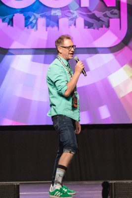 Host Chris Provost showing off his socks for the day, per Salt Lake Comic Con tradition. Photo: Lmsorenson.net