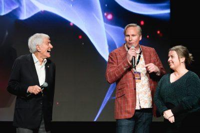 Comic Con heads Dan Farr and Bryan Brandenburg help Dick Van Dyke sing to his wife for her birthday. Photo: Lmsorenson.net