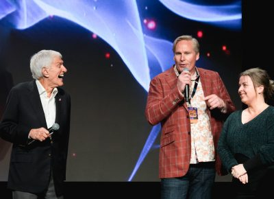Comic Con heads Dan Farr and Bryan Brandenburg help Dick Van Dyke sing to his wife for her birthday. Photo: Lmsorenson.net