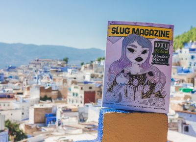 On the rooftop of the Aladdin restaurant in Chefchaouen, Morocco, SLUG Magazine overlooks the medina below. Photo: Talyn Sherer