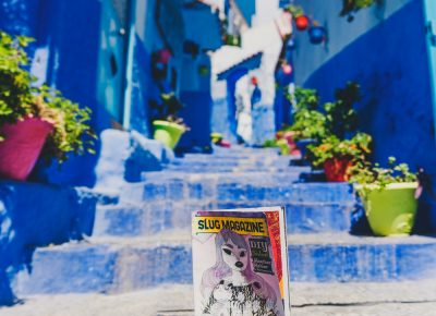 The infamous steps in the blue city of Chefchaouen finds a SLUG Magazine blending into its colorful display. Photo: Talyn Sherer