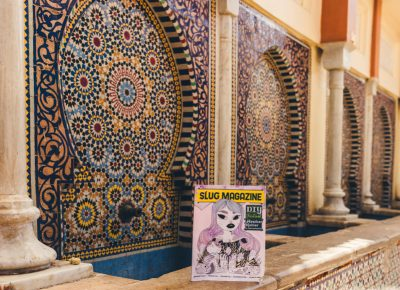 In the city of Fez, Morocco, a SLUG Magazine rests in the shade next to a traditional Moroccan mosaic fountain. Photo: Talyn Sherer
