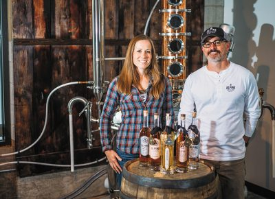 (L–R) Alpine Distilling's Sara Sergent and Managing Director Rob Sergent make spirits that cater to Utah's alpine lifestyle, starting with water in Silver Creek. Photo @clancycoop