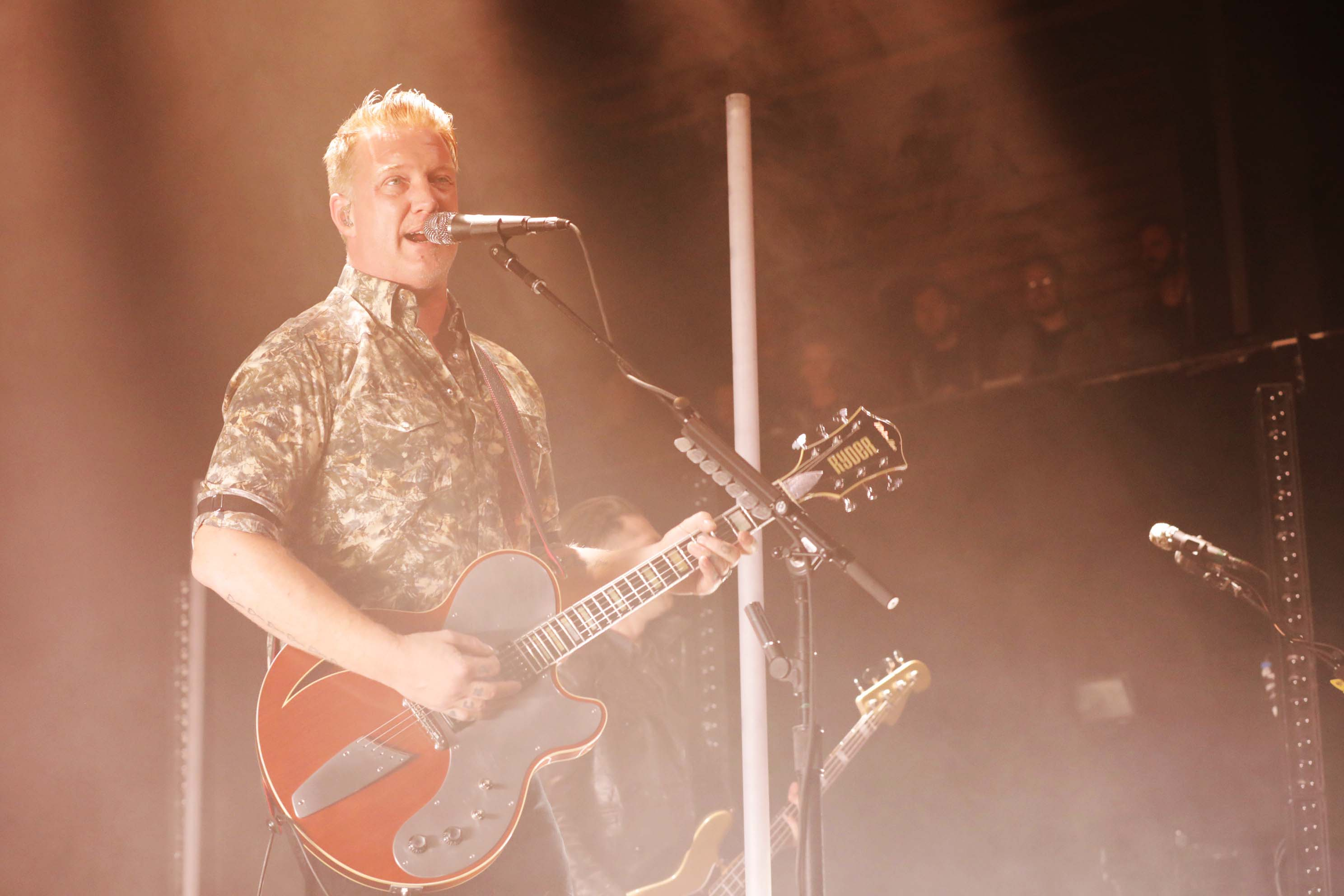 Lead singer Josh Homme rocking out while providing vocals for Queens of the Stone Age. Photo: Lmsorenson.net