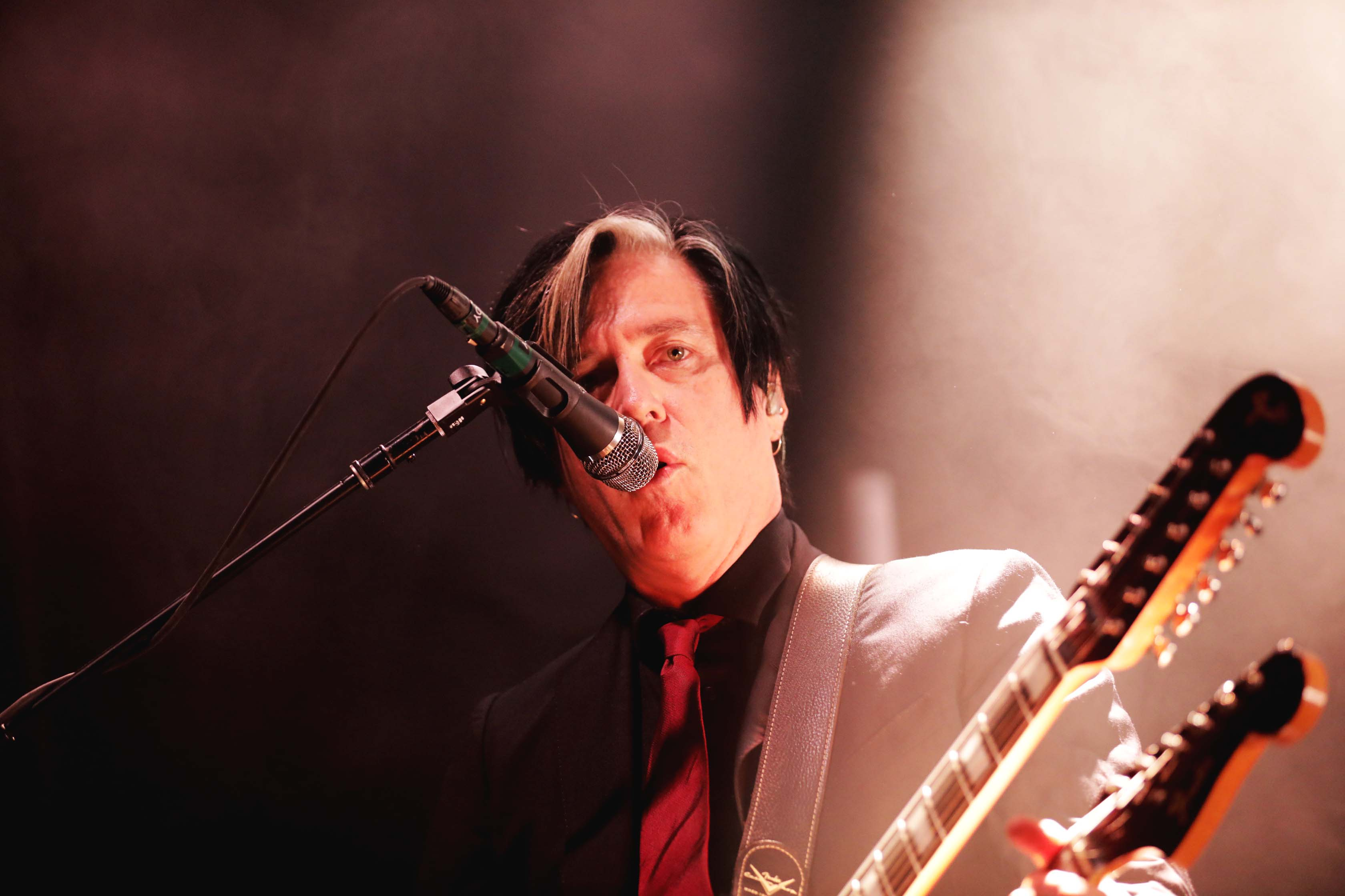 Guitarist Troy Van Leeuwen with a sweet double neck guitar. Photo: Lmsorenson.net