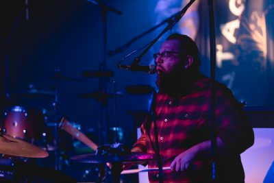 Drummer for Desi Valentine providing backup vocals. Photo: Lmsorenson.net