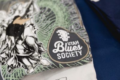 The Utah Blues Society has some snazzy thermal shirts for sale at a table inside the theater lobby. Photo: @Lmsorenson.net