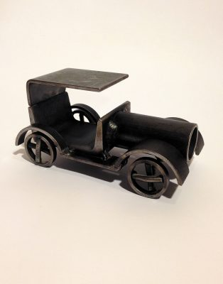 A welded toy car exchanged for Scarab Beetle. Photo: Clinton Whiting