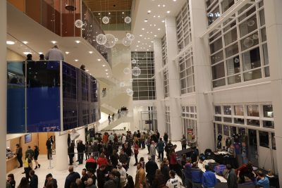The open-faced glass wall to downtown Salt Lake City and the many lines of attendees heading to their seats at the Eccles Theater. Photo: Lmsorenson.net