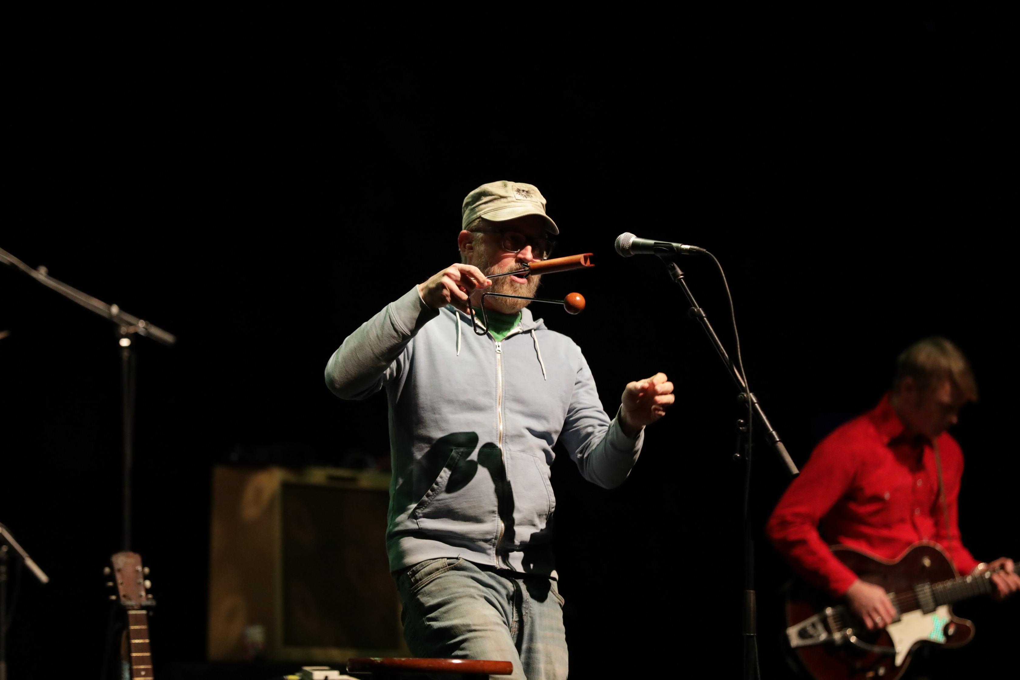 John McCrea plays the vibraslap, a signature instrument for CAKE's sound. Photo: Lmsorenson.net