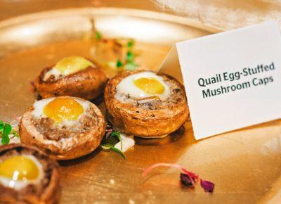 Quail-egg-stuffed mushrooms float across the room on their well-deserved golden thrones. Photo: Talyn Sherer