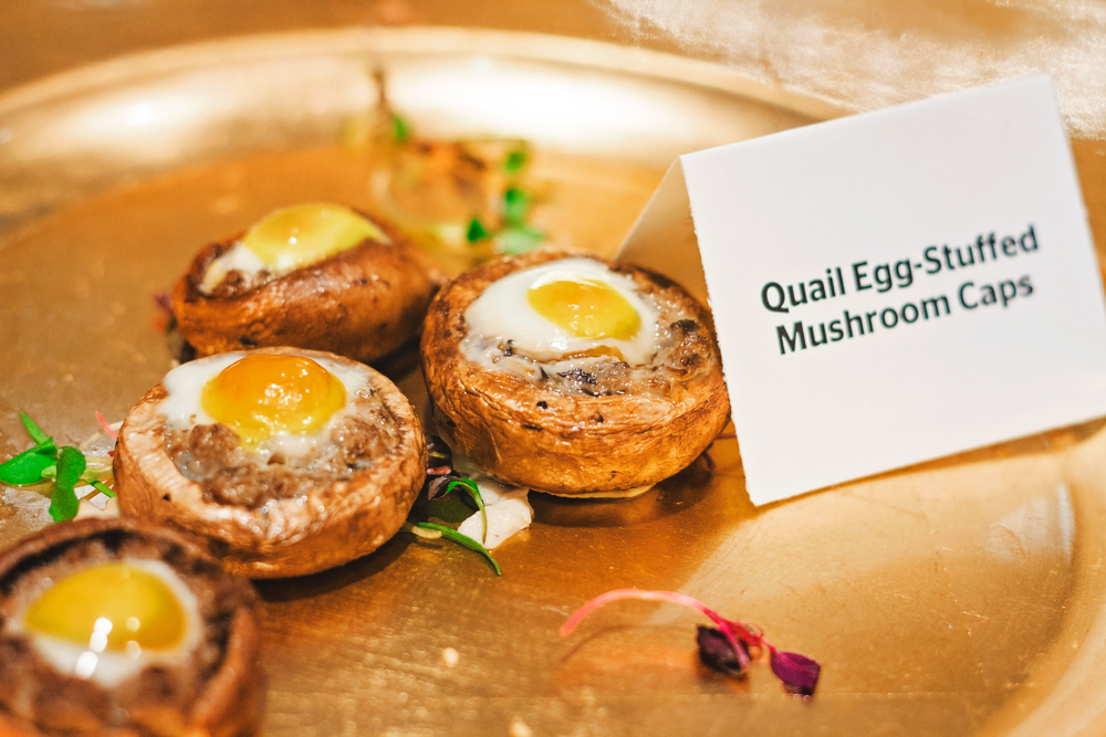 Quail-egg-stuffed mushrooms float across the room on their well-deserved golden thrones. Photo: Talyn Sherer