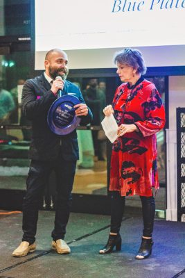 Randall Curtis of Harbor Seafood and Steak accepts his Blue Plate Award for being one of the many restaurants who expand food beyond the plate to the rest of the community. Photo: Talyn Sherer