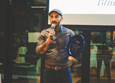 Moudi Sbeity talks about Laziz Kitchen's collaboration with the IRC and their efforts to feed new refugees arriving in Salt Lake. Photo: Talyn Sherer