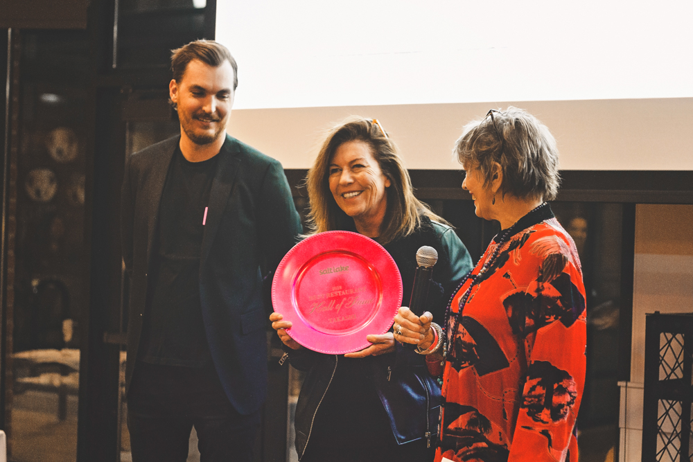 (L–R) Rich Romney and Tamara Gibo of Takashi receive their Hall of Fame award for consistency in excellence over the years. Photo: Talyn Sherer