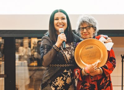 """Mary Brown Malouf, executive editor of Salt Lake Magazine, receives her """"Golden Palate"""" award given to her by her staff for her years of continued service to the food industry. Photo: Talyn Sherer"""