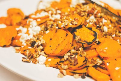 Cuisine Unlimited provided us with some charred sweet potato rounds topped with feta, pecans and puffed farro. Photo: Talyn Sherer