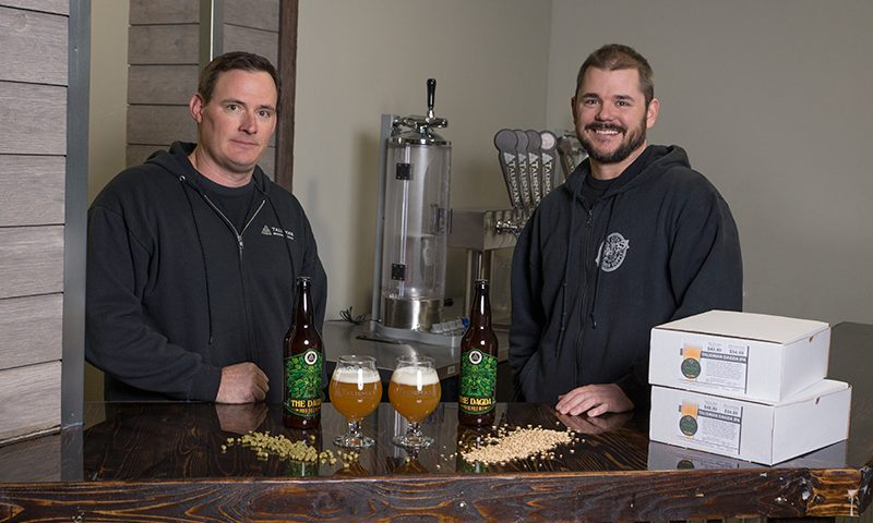 (L–R) Dusty Williams of Talisman and Cody McKendrick of OCBS. The two Ogden businesses teamed up in August to sell the popular Dagda IPA kit—the first Utah-beer clone recipe—for fans to brew their own five-gallon batches right at home. Photo: Chris Kiernan.