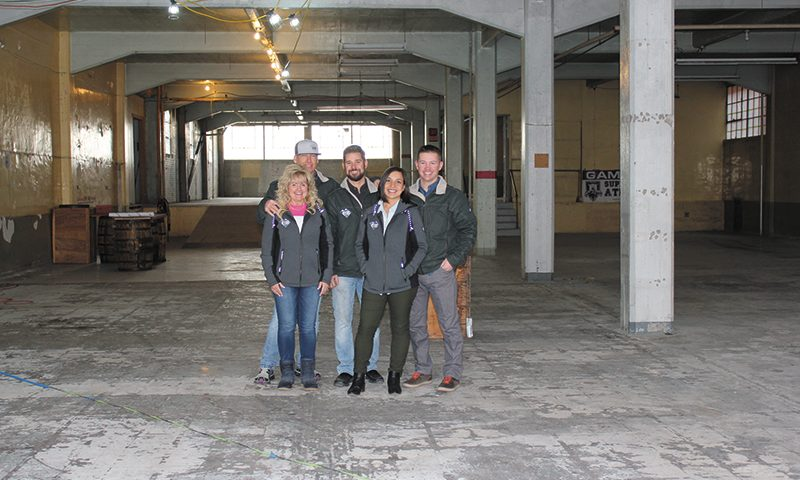 (L–R) UTOG's Suzie Hubble, Jack Hubble, Jeff Manwaring, Cassandra Foss and Carson Foss in their brewery-to-be in Ogden. Photo: Sylvia Hollands