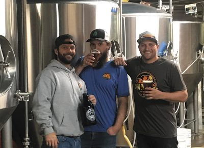 (L–R) Zion Brewery Assistant Brewer Jay Mecham, Head Brewer Jeremy Baxter and Sales and Distribution Manager Frank Giammalva have stewarded the brewery's successful rebranding. Photo courtesy of Zion Brewery