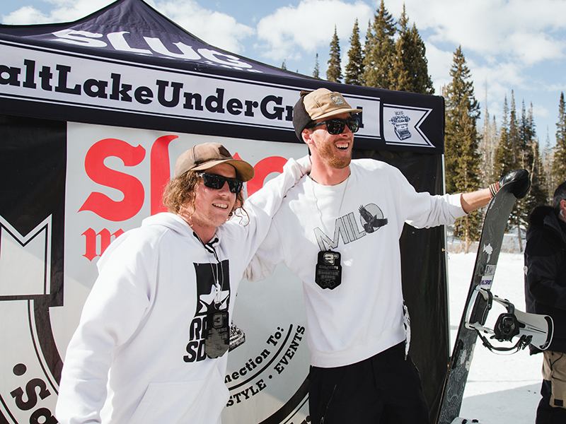 (L–R) Jeff Hopkins (Third) and Treyson Allen (Second) claiming medals in the Men's Open Snowboard Division. Pat Fava, not pictured, won First in the Men's Open Snow division. Photo: Matthew Hunter