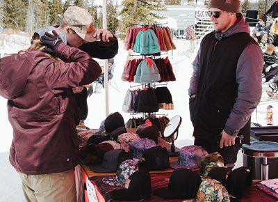 A few attendees checking out Izm's goods. Photo: Matthew Hunter