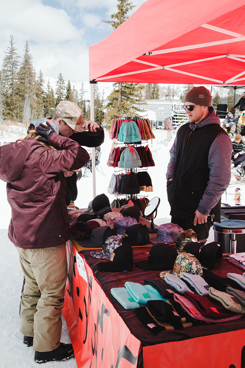 A few attendees checking out Izm's goods. Photo: Matthew Hunter