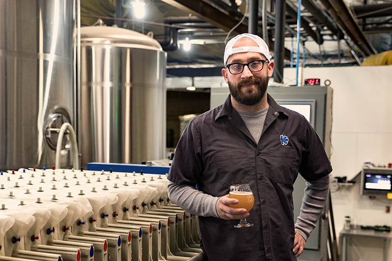 """With new, local ingredients and a sustainability-forward ethos, Kiitos Brewing Head Brewer Clay Turnbow is an avid drinker and maker of """"out-there"""" beers. Photo: LMSorenson.net"""