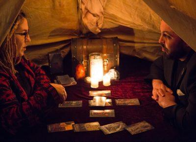 Alex Ortega listens intently to his tarot reading. Photo: Jessica Bundy