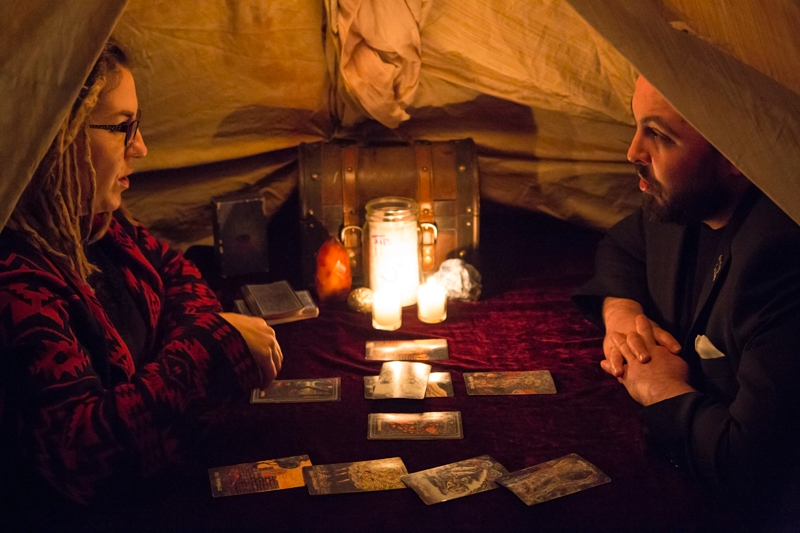 Alex Ortega listens intently to his tarot reading. Photo: Jessica Bundy