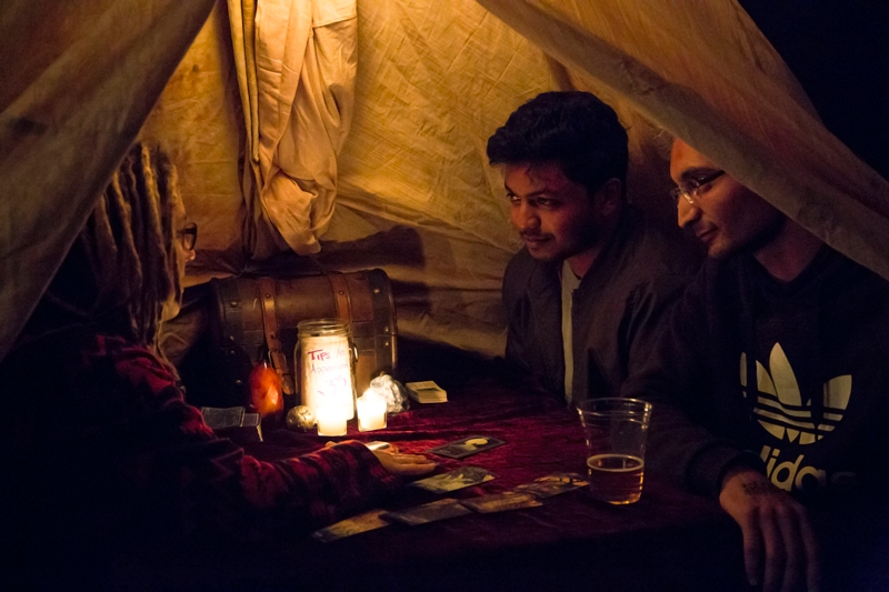 Patrons Vinay and Maneesh enjoying their tarot reading. Photo: Jessica Bundy