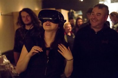 A patron trying the VR headset and loving it! Photo: Jessica Bundy