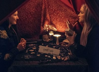 Brooke South gives a tarot card reading to SLUG's own Angela Brown. Photo: Will Cannon