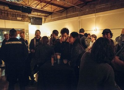 A crowd enjoying the drinks and food in the tarot lounge of RYE. Photo: Will Cannon